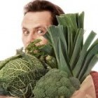 a man with different vegetables